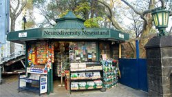 Image of classic New York City newsstand. The top reads Neurodiversity Newsstand.